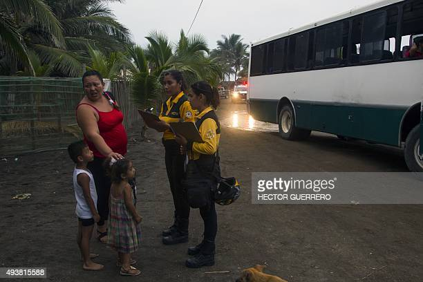 Residents of Boca de Pascuales Colima State Mexico prepare to be evacuated on October 22 before the arrival of hurricane Patricia Fastmoving Patricia...