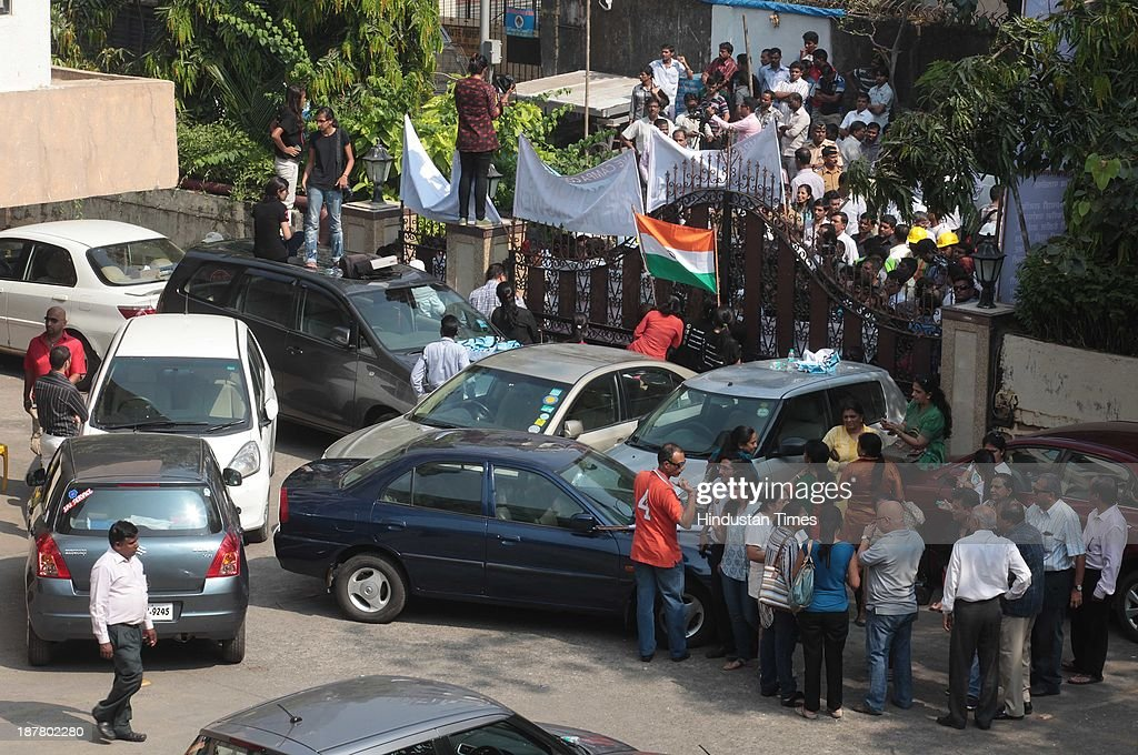 Residents of Campa Cola Compound locked their gates and barricaded themselves to block the entry of BMC officials who reached at the spot to begin demolition process on November 12, 2013 in Mumbai, India. Seven high-rises were constructed at what is called the Campa Cola Compound, between 1981 and 1989. The builders had permission for only five floors, but constructed several more. One of the buildings, Midtown, has 20 floors. Another building, Orchid, has 17. The Supreme Court asked the BMC to investigate, and the civic body served demolition notices for all flats constructed above the fifth floor, which it said were illegal.