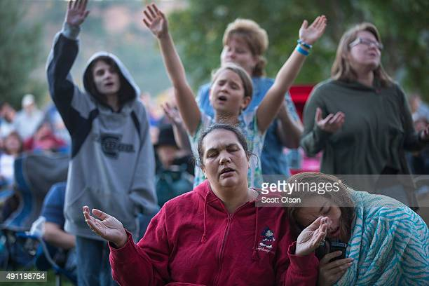 Residents of Douglas County attend a prayer service and candlelight vigil at River Bend Park to remember the victims of the mass shooting at Umpqua...