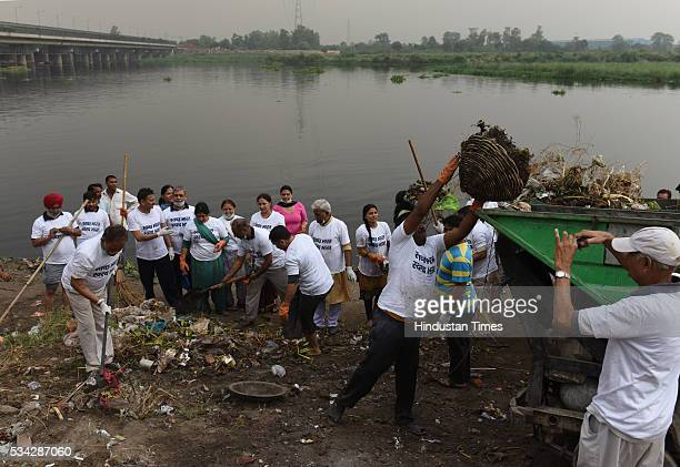 Residents of east Delhi along with BJP workers and Yuva BJP members participate in cleaning the Yamuna River as a part of the Swachh Bharat Abhiyan...