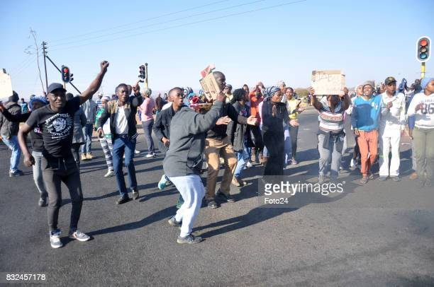 Residents of GaRankuwa protesting and blocking roads on August 14 2017 in Tshwane South Africa Angry residents demand service delivery to fix blocked...