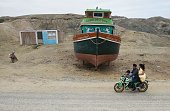Residents of Islilla in Piura northern Peru ride ona motorbike on July 14 2016 Overfishing has put in risk the subsistence of the 30000 artisanal...