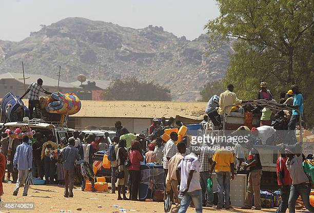 Residents of Juba with their belongings pile onto vehicles heading out of the city on December 21 2013 where tension remains high fueling an exodus...