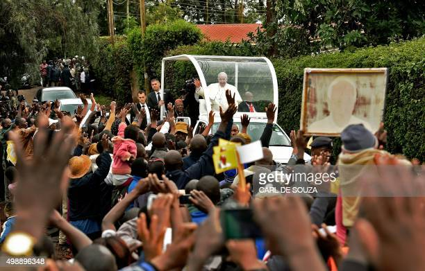 Residents of Kangemi slum welcome Pope Francis during his visit to Africa in Nairobi on November 27 2015 Authorities plan to deploy over 10000 police...