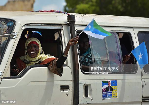 Residents of Kismayo wave flags as they campaign for their candidate on November 15 2016 Somalia is in the process of selecting a new parliament...