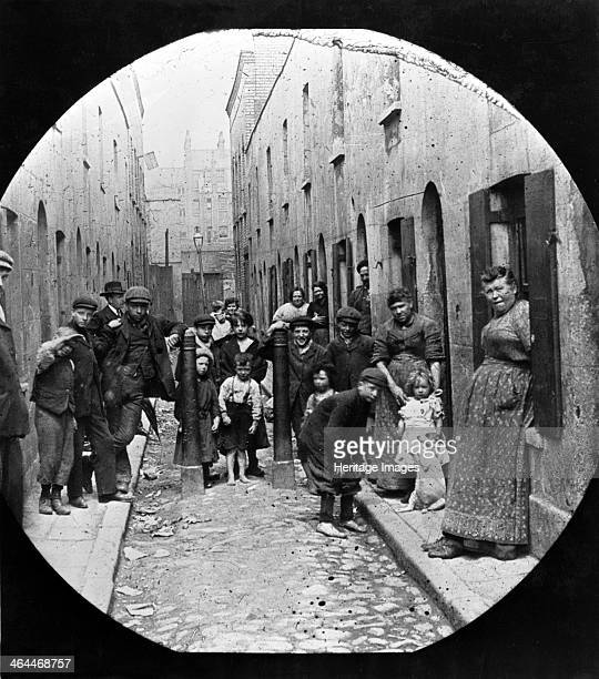 Residents of Little Collingwood Street Bethnal Green c1902 Residents of the street pose for the photographer Two of the boys in the front of the...