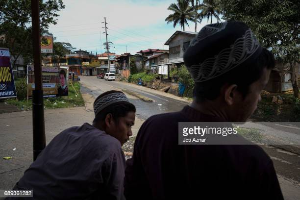 Residents of Marawi in the city while it was sieged by ISISlinked militants on May 25 2017 in Marawi city southern Philippines Filipino authorities...