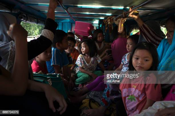 Residents of Marawi who escaped the fighting inside the city being sieged by ISISlinked militants endure hours of travel inside overloaded vehicles...
