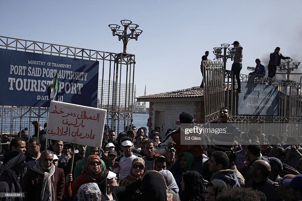Residents of Port Said gather at a dock on the Suez Canal to demonstrate after the announcement of the final verdict in the case of the Port Said...
