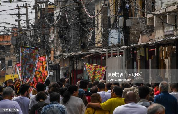 Residents of Rio de Janeiro's Jacarezinho and Manguinhos favelas march in demand of peace in Rio Brazil on August 20 2017 In the first half of this...