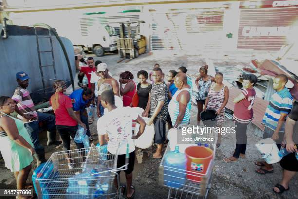 Residents of Saint Martin wait in line for water on September 11 2017 in Philipsburg St Maarten The Caribbean island sustained extensive damage from...
