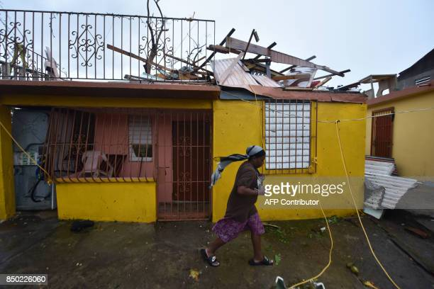 Residents of San Juan Puerto Rico deal with damages to their homes on September 20 as Hurricane Maria batters the island Maria slammed into Puerto...