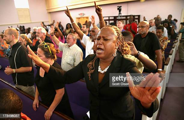Residents of Sanford Florida attend a prayer vigil to promote peace and unity in the community in the wake of the George Zimmerman trial on July 15...