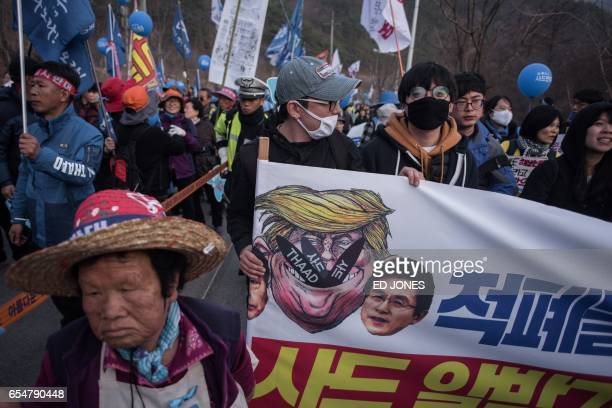 Residents of Seongju county participate in a protest against the recently installed US Terminal High Altitude Area Defense system nearby in Seongju...