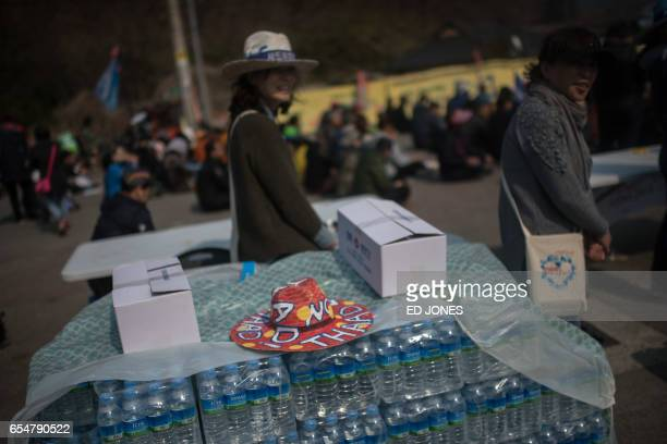 Residents of Seongju county participate in a protest outside a golf course being used as the site for the recently installed US Terminal High...