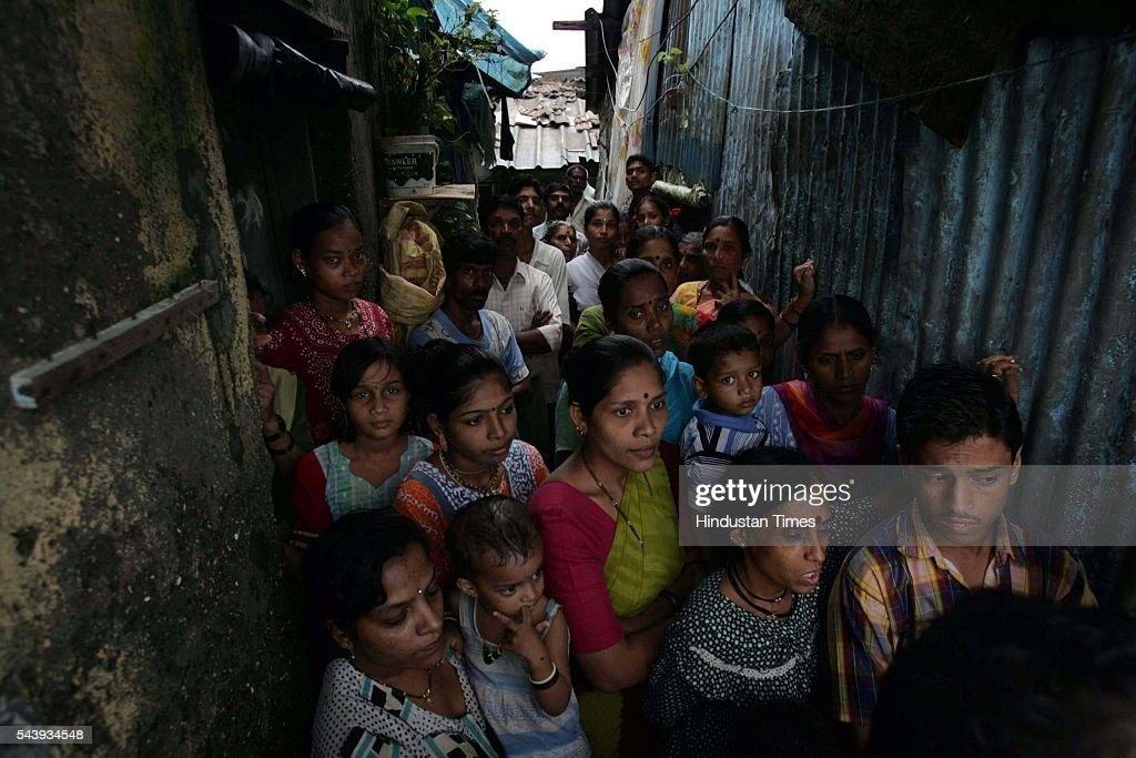Residents of Shivneri Shanti Chawl, Kurla wait in line for their turn to receive aid after 26 July flood.