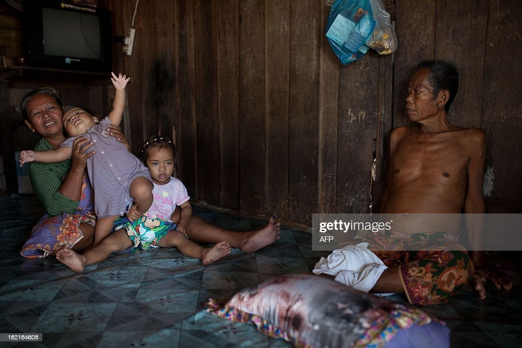 Residents of Tanduo village, where suspected Philippine militants are holding offout, gather at their relative house in Tanjung Labian, near Lahad Datu, on the Malaysian island of Borneo on February 20, 2013. Followers of a Philippine sultan who crossed to the Malaysian state of Sabah this month will not leave and are reclaiming the area as their ancestral territory, the sultan said on February 17 amid a tense stand off.