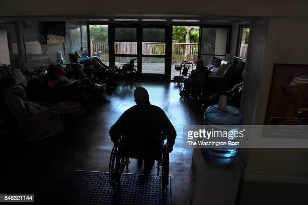 Residents of the Cape Coral Shores memory care facility kill time because due to the power outage they can't watch TV or listen to the radio They...