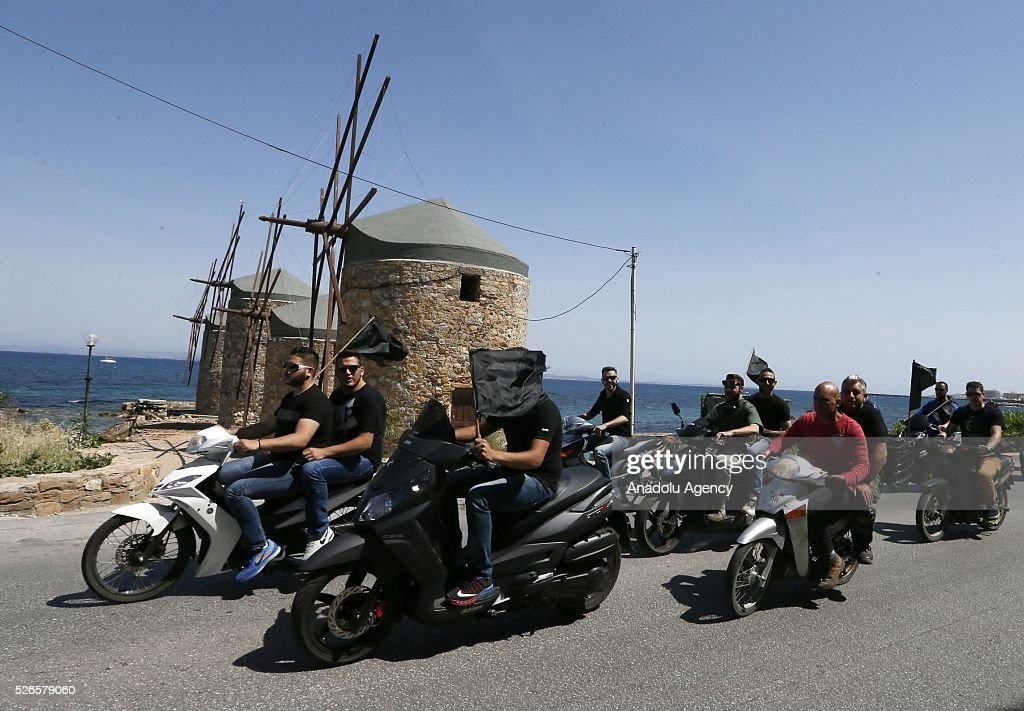 Residents of the Chios Island gather to protest against the cancellation of 'the rocker war' outside the Agios Markos Church in Chios Island, Greece on April 30, 2016. Greek Orthodox Easter celebration 'Rocket War' which takes place between two local churches of Panaghia Erithiani and Aghios Marko at the Vrontados village is cancelled after some villagers had complained about the fireworks.