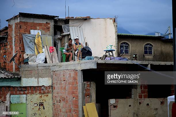 Residents of the Cidade of Deus favela wait for the beginning of the BrazilianFrench 'Planeta Ginga' film and music free festival at the Cidade de...