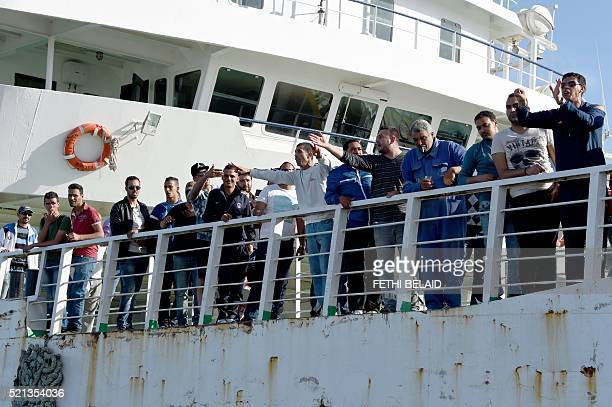 Residents of the city of Sfax shout slogans towards police on April 15 2016 as reinforcments take a boat to the island of Kerkennah where clashes...