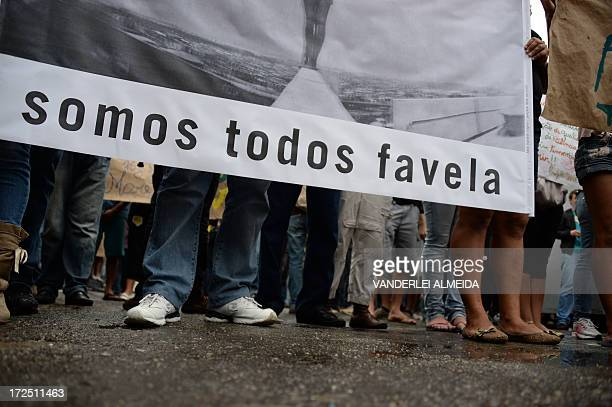 Residents of the Favelas de Mare complex in Rio de Janeiro march during a protest against violence by the militarized police on July 2 2013 Last week...