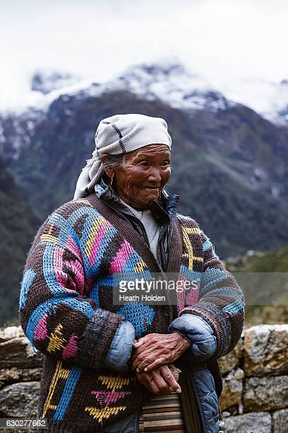 Residents of the Himalayas live and work a hard life this Sherpa woman walking a ridgeline trail on September 21 2016 in Namche Bazar Nepal The...