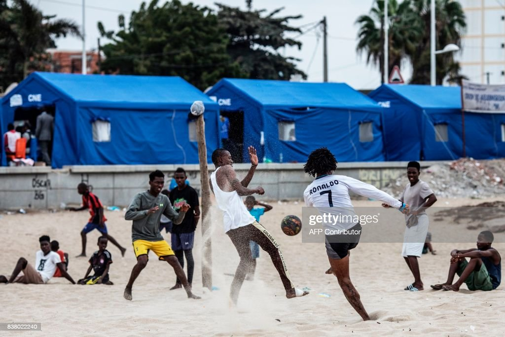 Residents of the Ilha de Luanda play a football match on the beach in front of a polling station installed in tents on the waterfront in Luanda, on August 23, 2017. Angolans voted on August 23 in an election marking the end of President Jose Eduardo dos Santos's 38-year reign, with his MPLA party set to retain power despite an economic crisis. /