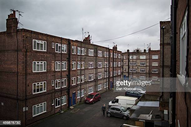 Residents of the New Era housing estate in East London return home on December 2 2014 in London England On Monday many of the residents marched in...