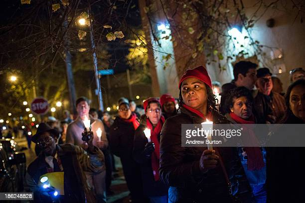 Residents of the Red Hook neighborhood of Brooklyn march through the streets after attending a candle light vigil to commemorate the one year...
