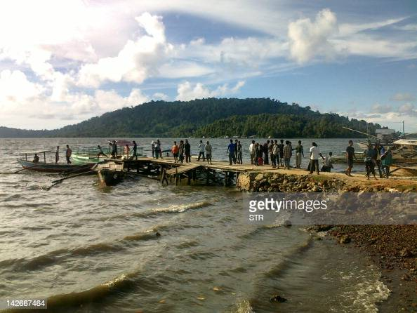 Residents of the remote Simeuleu island near Aceh observe the sea level in their bay on April 11 after a powerful earthquake hit the western coast of...