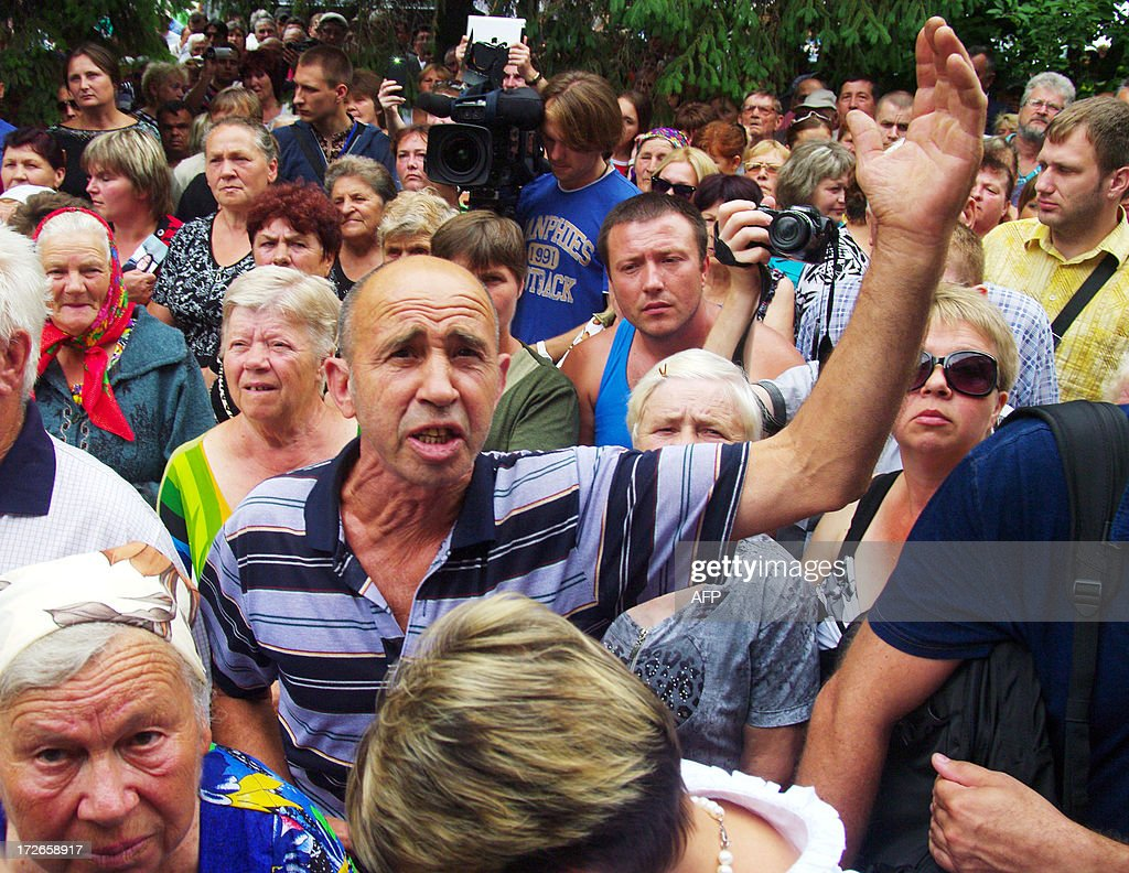Residents of the small Ukrainian city of Vradiyivka, in Ukraine's Mykolayiv region, protest outside of the police station on July 4, 2013. Several hundred protesters stormed a police station in southern Ukraine on July 2 after authorities initially failed to arrest one of two policemen implicated in the brutal rape of a young woman. The huge outrage prompted Ukraine's President Viktor Yanukovych to order a top-level enquiry into the gang rape of 29-year-old Iryna Krashkova.