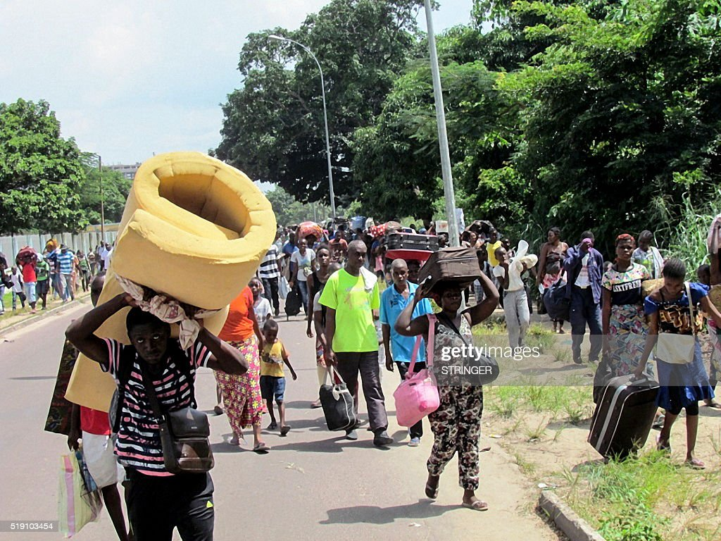 Residents of the southern districts of Brazzaville flee clashes between Congolese security forces and unknown assailants on April 4 2016 Clashes...
