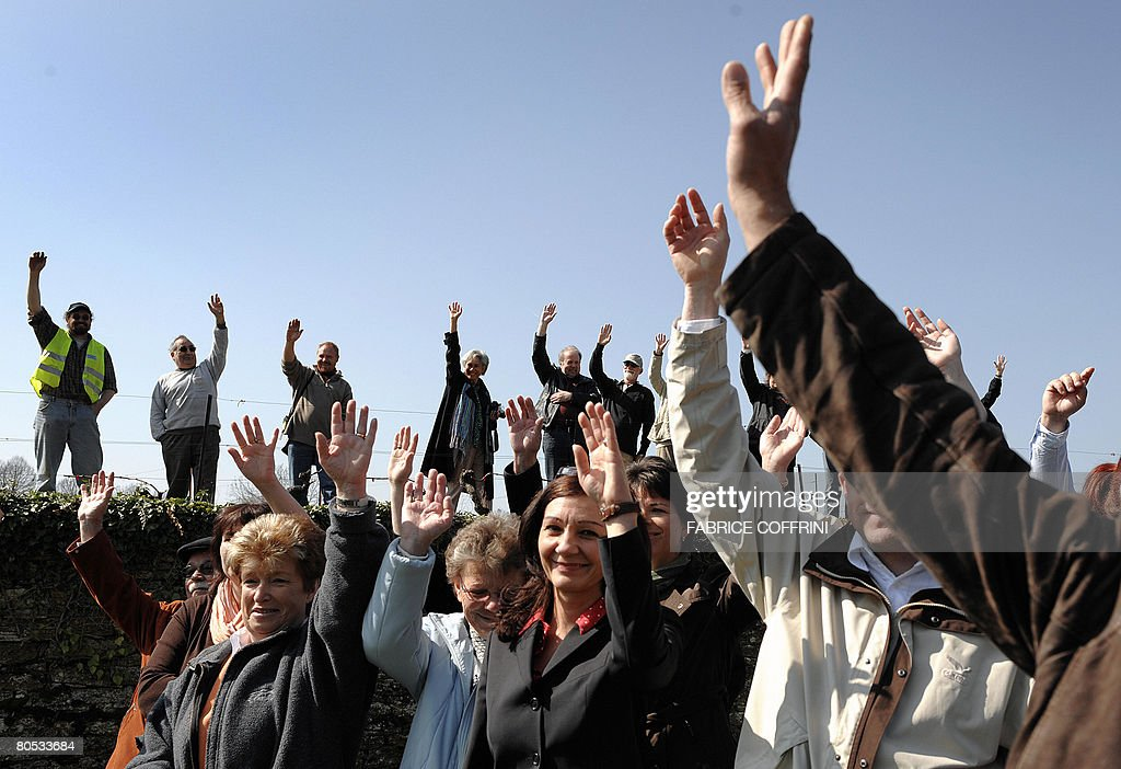 Residents of the Swiss village of Champagne gesture during a rally on April 5 2008 The tiny Swiss village of Champagne is protesting against its...