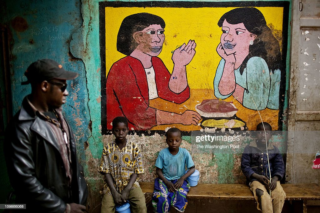 Residents of the town of Niono, near the frontline, spend time outside a local restaurant on January 20, 2013. For the last week, French and Malian forces fought to route Islamic militants from the town.