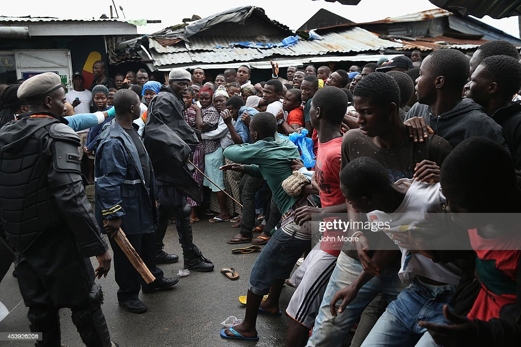 Residents of the West Point slum wait for food aid during the second day of the government's Ebola quarantine on their neighborhood on August 21, 2014 in Monrovia, Liberia. The government delivered bags of rice, beans and cooking oil to residents, who are forbidden from leaving the seaside slum, due to the Ebola outbreak in their community. More than 1,200 people have died due to the Ebola epidemic in West Africa.