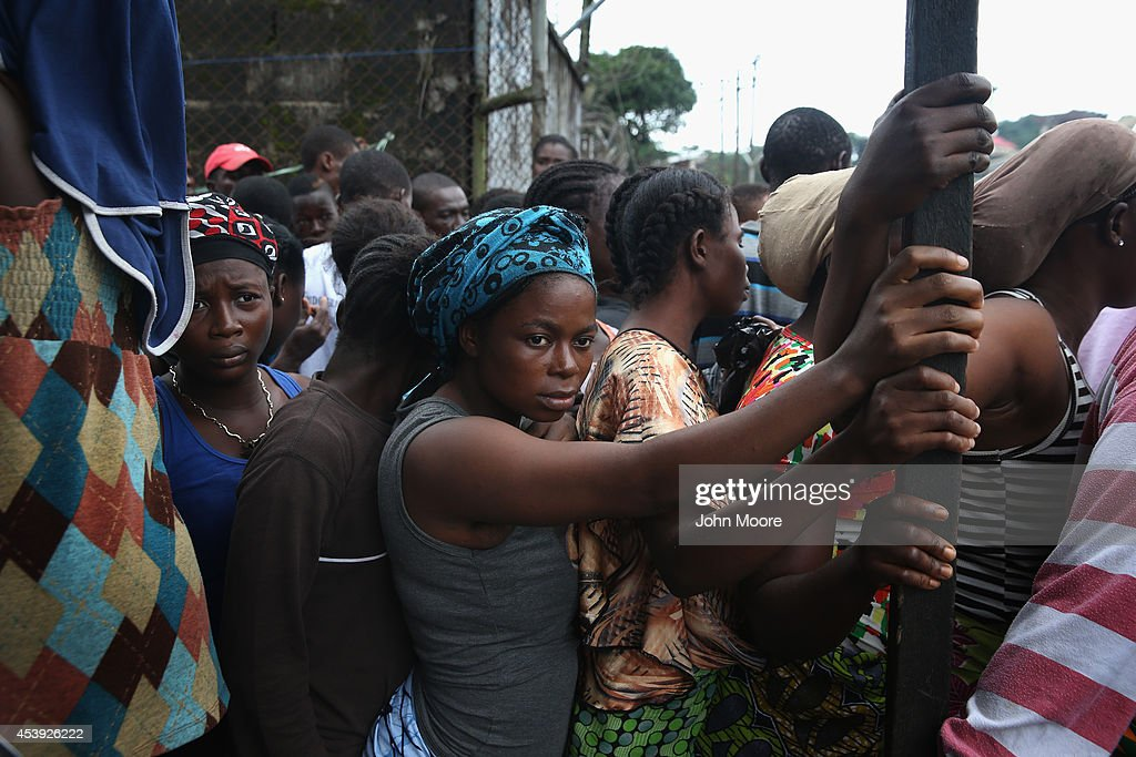 Residents of the West Point slum wait for food aid during the second day of the government's Ebola quarantine on their neighborhood on August 21 2014...