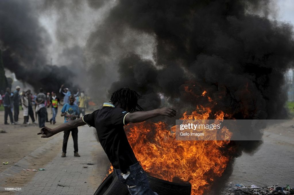 Residents of the Zamdela township burn tires in the streets of Sasolburg on January 20, 2013, in Sasolburg, South Africa. Residents of the Zamdela township took to an illegal march after the announcement of the changing of all municipal systems from Sasol to Parys.