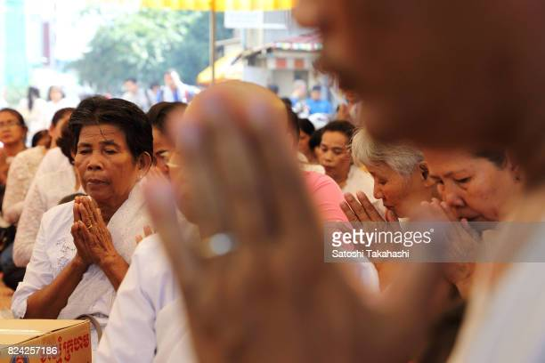 Residents of White Building pray to God during a farewell ceremony at Phnom Penh's iconic White Building It was built in 1963 as a modern Municipal...