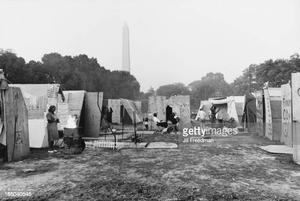 Residents outside their shelters relax in the shadow of the Washington Monument in Resurrection City a three thousand person tent city on the...