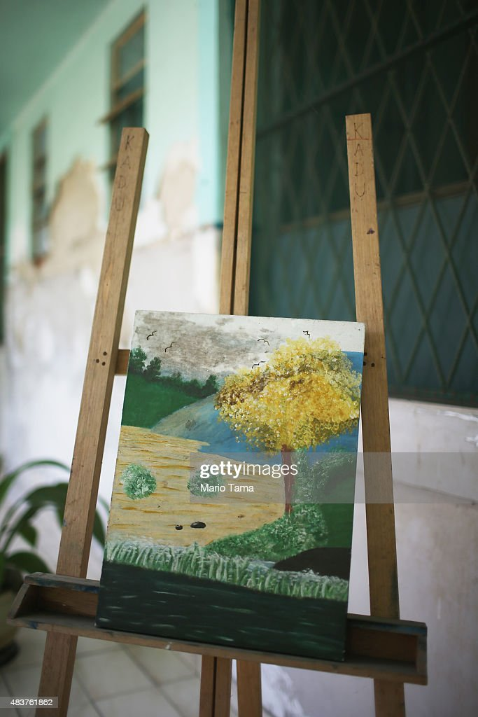A resident's painting rests on an easel at Hospital Curupaiti part of a former leprosy colony on June 10 2015 in the Jacarepagua neighborhood of Rio...