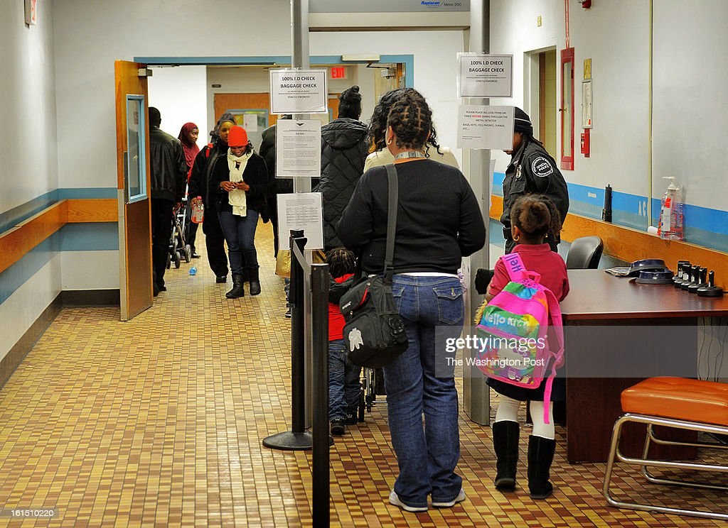 Residents pass through a security checkpoint at the Districts' homeless shelter in what once was DC General hospital on February, 11, 2013 in Washington, DC.