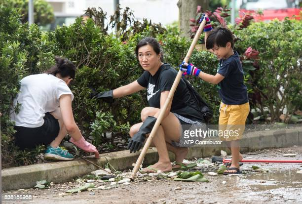 Residents pick up polystyrene and other rubbish in Heng Fa Chuen in Hong Kong on August 24 a day after Typhoon Hato created a sea surge which flooded...