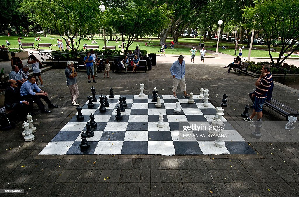 Residents play a game of chess on a giant chessboard in Sydney's Hyde Park on January 3, 2013. Spread over 40 acres in Sydney's central business district, Hyde Park is the oldest public parkland in Australia.