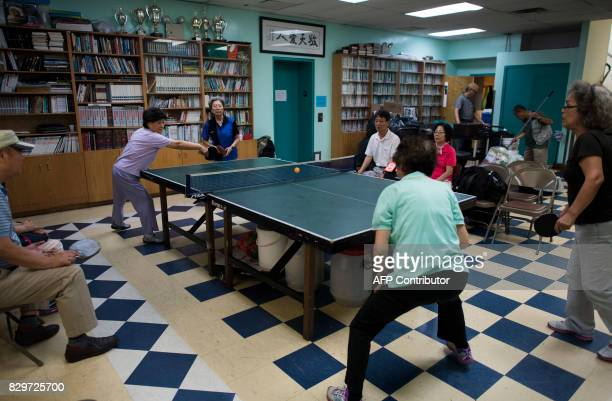 Residents play ping pong at the Korean Community Services center on August 10 in New York Most of those at the center said they hope that diplomacy...