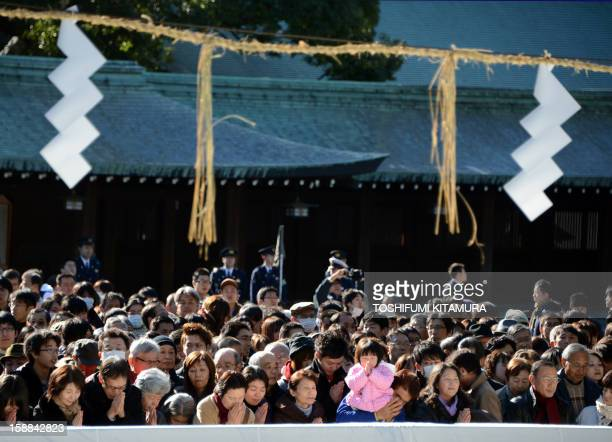 Residents pray to mark New Year's Day at Meiji shrine in Tokyo on January 1 2013 About three million people were expected to visit the shrine to pray...
