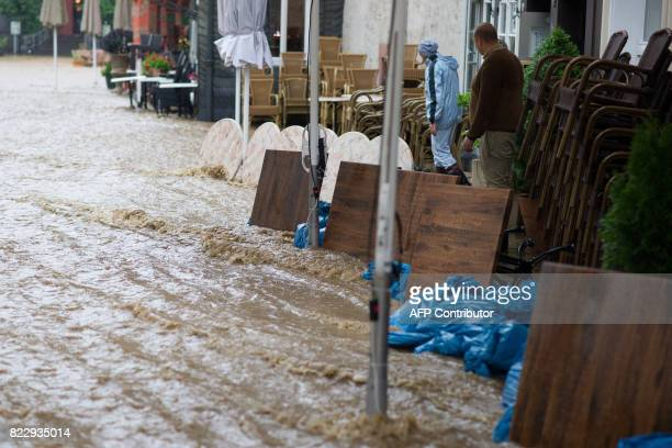 Residents protect the houses against water with tables in Goslar northern Germany after heavy rainfall on July 26 2017 Ongoing rainfall led to...