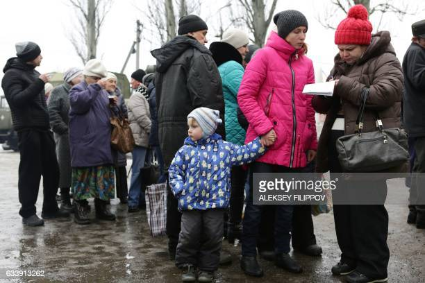 Residents queue to get warm clothes received as humanitarian aid in Avdiivka Donetsk region on February 5 2017 Fighting subsided around a flashpoint...