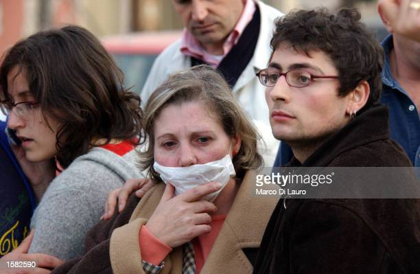 Residents react after another earthquake aftershock shakes the town of San Giugliano di Pugia November 1 2002 located approximately 37 miles south...