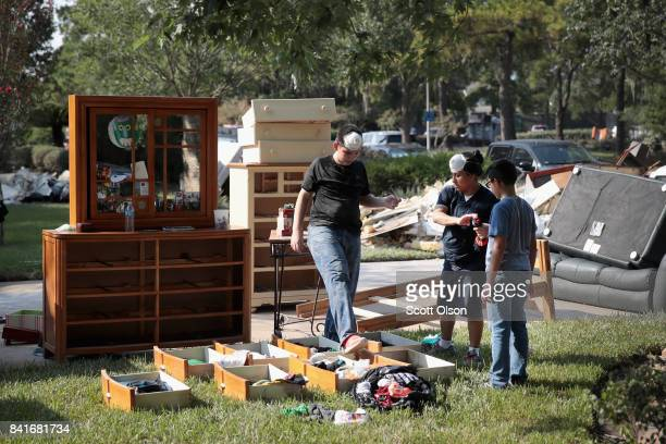 Residents recover from damage to their homes after torrential rains caused widespread flooding during Hurricane and Tropical Storm Harvey on...